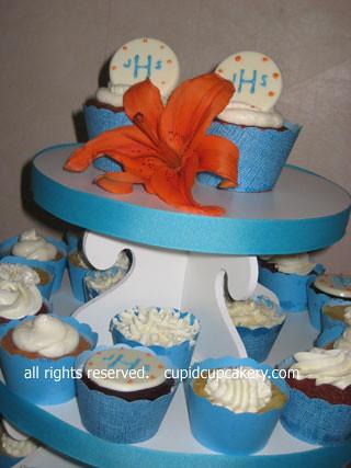 Aqua and Orange Monogrammed Wedding Cupcakes by Cupid Cupcakery