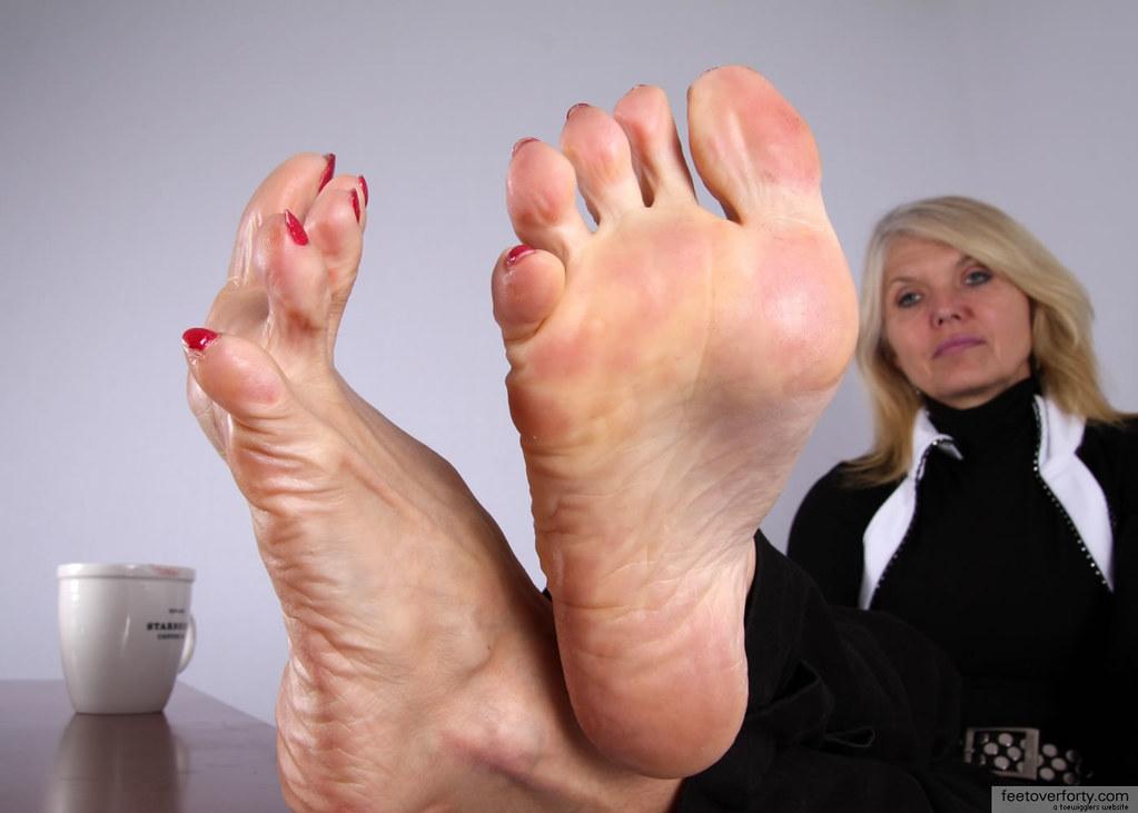 Mature foot licking
