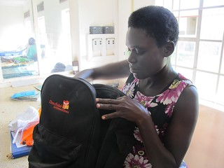 Midwife at Tiriri Health Center unpacks Direct Relief midwife supply kit