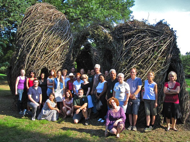 BBG staff and volunteers with artist Patrick Dougherty and his sculpture Natural History. Photo by Rebecca Bullene.