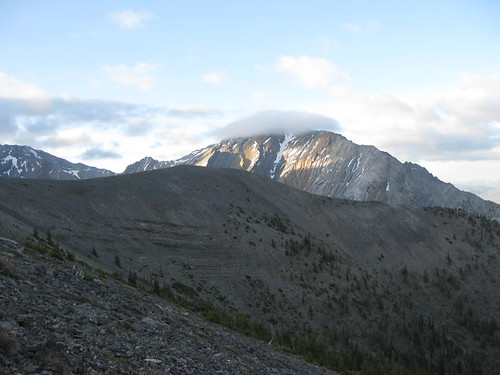 The Borah Peak summit, capped by clouds.