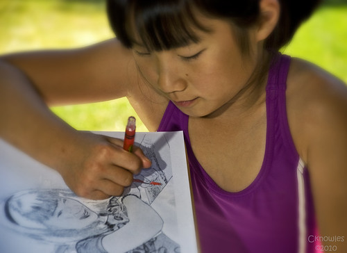 Daughter colors a picture of herself
