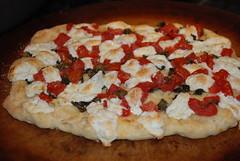 tarte flambã©e(0.0), bruschetta(0.0), pizza cheese(1.0), pizza(1.0), baked goods(1.0), produce(1.0), food(1.0), focaccia(1.0), dish(1.0), dessert(1.0), cuisine(1.0),