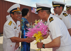 In this file photoe, Cmdr. Jeffrey Kim, commanding officer of the guided missile destroyer USS John S. McCain (DDG 56), greets a senior officer of the Vietnam People's Navy following the ship's arrival to Da Nang Aug. 10, 2010. (U.S. Navy photo by Mass Communication Specialist 1st Class Brock A. Taylor)