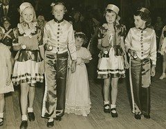 Young children from the Windsor School of Arts dressed in costume as ushers and usherettes
