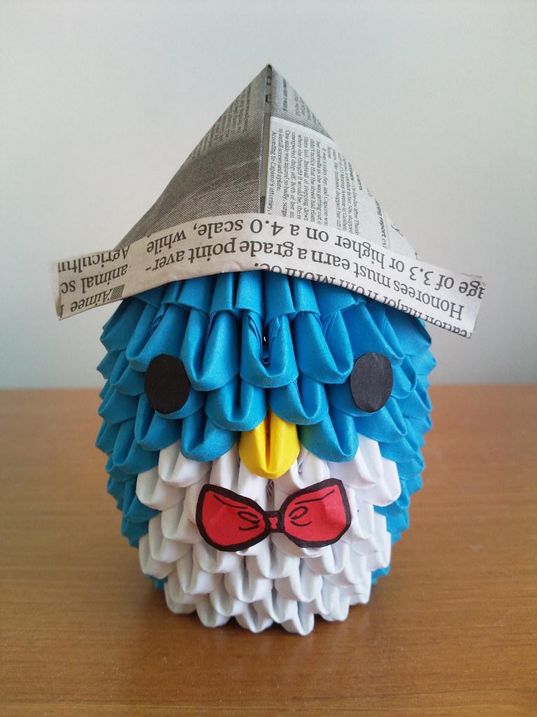 Origami Penguin Wearing Newspaper Hat