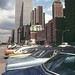 World Trade Center with lots of colorful 1970s cars by West Street. May 1973. New York