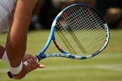 ball(0.0), strings(1.0), tennis(1.0), sports(1.0), rackets(1.0), tennis player(1.0), net(1.0), ball game(1.0), racquet sport(1.0),