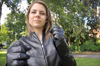 Girl in leather gloves and jacket (18+ years)