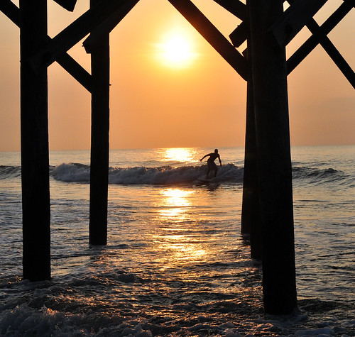 ocean sea reflection sc water silhouette sunrise pier surf surfer southcarolina wave pawleysisland explored