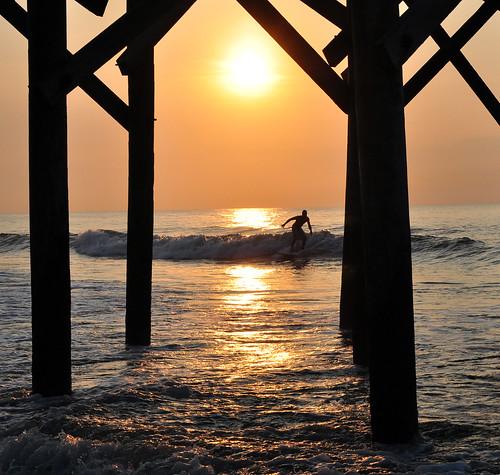 ocean sea reflection sc water silhouette sunrise pier surf surfer southcarolina wave pawleysisland explored