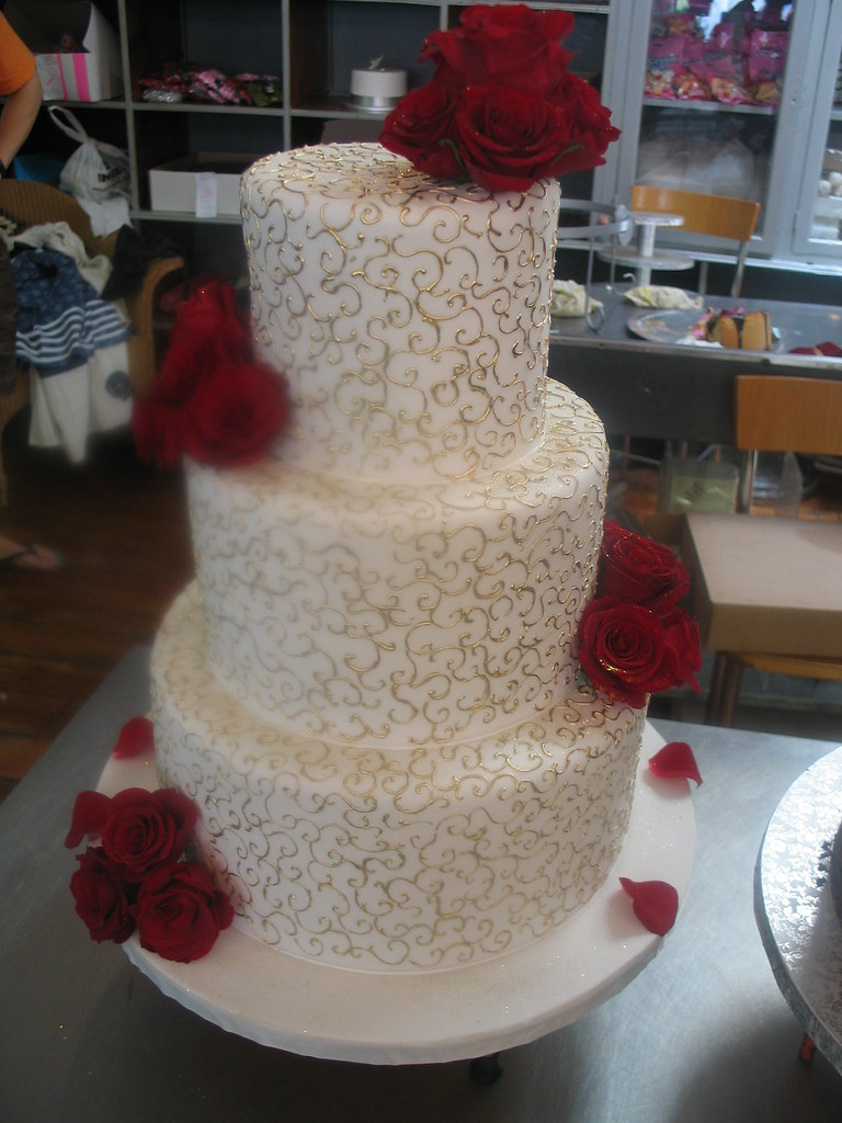3 Tier Wicked Chocolate Wedding Cake Iced With Gold Twirls And Red