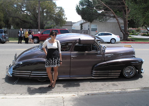 I'm a Chicana. I was made to pose next to bombs (old school cars).