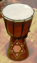 bass drum(0.0), timbale(0.0), snare drum(0.0), drums(0.0), timbales(0.0), tom-tom drum(1.0), percussion(1.0), drum(1.0), bongo drum(1.0), djembe(1.0), hand drum(1.0), skin-head percussion instrument(1.0),
