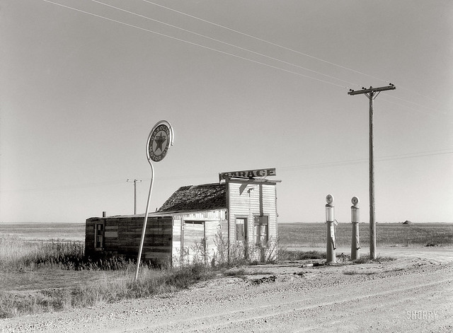 Last Chance Texaco, abandoned garage on Highway 2, western North Dakota, by Russell Lee 1937