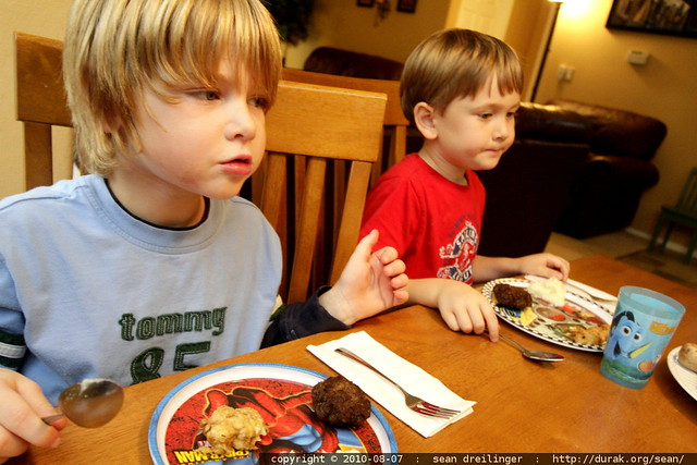 two kids at the dinner table