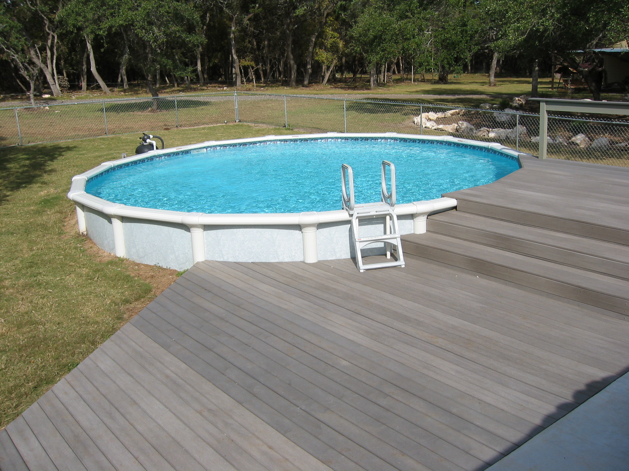 Round above groundpool with composite decking comal for Above ground pool composite decks