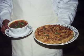 Chef  Tanzeel with potato stuffed paratha and a bowl of lentils