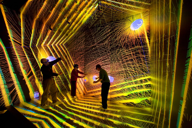 Researchers investigate details of an astronomical simulation in the CAVE at the Los Alamos SuperComputing Center. CAVE stands for Cave Automatic Virtual Environment or immersive virtual reality environment.  Photo by LeRoy Sanchez.