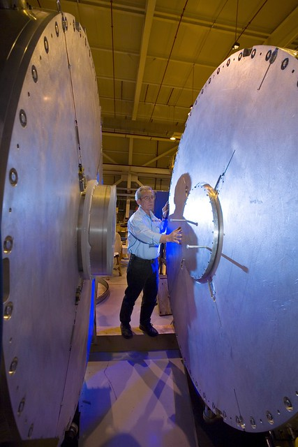 David Honaberger with Los Alamos National Laboratory (LANL) examines one of the refurbished accelerator cells for DARHT's (Dual Axis Radiographic Hydrotest Facility) second-axis accelerator.   Photo by LeRoy Sanchez.