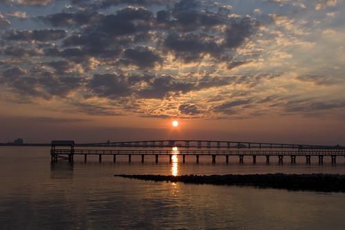 ocean bridge sunset sea sky sun beach water clouds sunrise mississippi landscape coast pier skies gulf biloxi gulfport frontbeach gulfcoast oceansprings