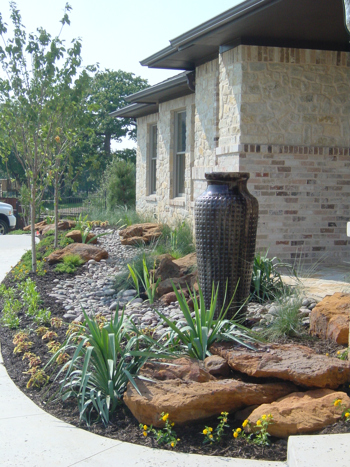 Custom landscape design flowermound texas small boulders for Garden design landscaping dallas tx