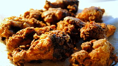 vegetable(0.0), baking(0.0), coconut(0.0), produce(0.0), dessert(0.0), meal(1.0), breakfast(1.0), chicken meat(1.0), fried food(1.0), chicken fingers(1.0), meat(1.0), fritter(1.0), pakora(1.0), food(1.0), crispy fried chicken(1.0), dish(1.0), cuisine(1.0), snack food(1.0), fried chicken(1.0), fast food(1.0),