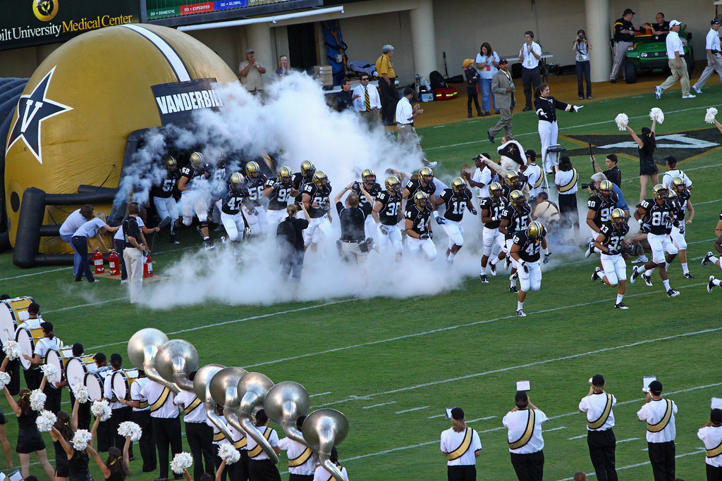 vanderbilt football team running onto the field