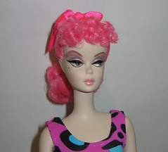 purple(0.0), blond(0.0), barbie(0.0), face(1.0), hairstyle(1.0), clothing(1.0), lip(1.0), head(1.0), hair(1.0), wig(1.0), pink(1.0), doll(1.0), toy(1.0),