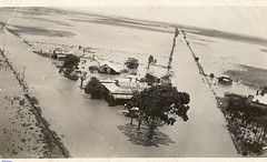 A view of the Long Plains Store during flooding of the area in 1941.