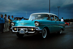 chevrolet(0.0), coupã©(0.0), convertible(0.0), automobile(1.0), automotive exterior(1.0), 1957 chevrolet(1.0), vehicle(1.0), automotive design(1.0), compact car(1.0), antique car(1.0), sedan(1.0), land vehicle(1.0), luxury vehicle(1.0), motor vehicle(1.0),