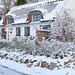 Snow covered thatched cottage in Denmark