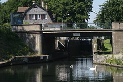 boathouse(0.0), rolling stock(0.0), moat(0.0), water(1.0), river(1.0), reflection(1.0), canal(1.0), waterway(1.0), bridge(1.0),