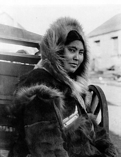 Eskimo woman in fur trimmed costume