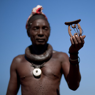 Himba man with his headrest - Angola