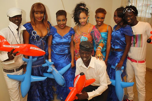 <p>Oumou Sow and her backup dancers await their turn onstage. They are holding inflatable airplanes to accessorize their dance and song about mobility.</p>