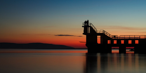 ireland sunset reflection galway silhouette contrast scarlet connemara blackrock divingboard flatcalm
