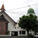 Gereja dan masjid. : A church and a mosque located next to each other.  Photo by Rifai