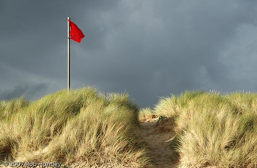 Red danger flag on a beach