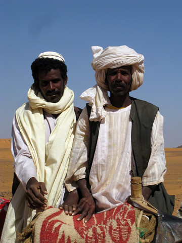 Camel men at the ancient Nubian pyramids at Meroe, Sudan | by retrotraveller