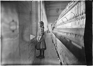 Rhodes Mfg. Co. Spinner. A moments glimpse of the outer world. Said she was 11 years old. Been working over a year. Lincolnton, N.C., 11/11/1908