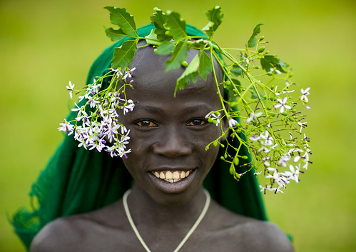 Surma kid with flowers - Tulgit Ethiopia