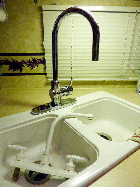 how to install a kitchen sink bob vila replace outdoor fauce