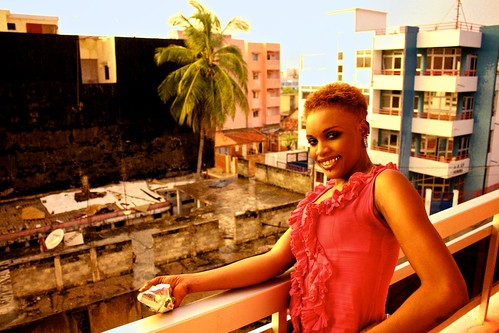 <p>One of Oumou Sows backup dancers hangs out, snacks in hand, after the show.</p>