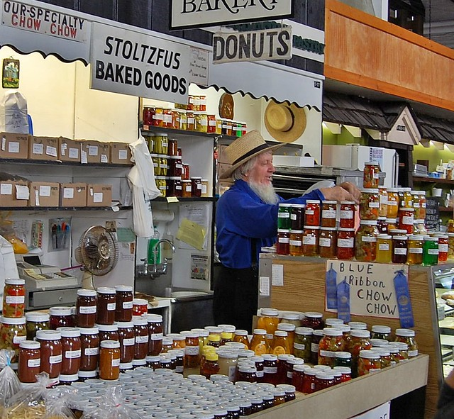 Amish man selling jellies and preserves - Stoltzfus Baked Goods stall at indoor market. | Central Market | Lancaster, PA