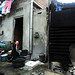 Mencuci di depan rumah. : Residents washing laundry in front of their home. Photo by Ardian