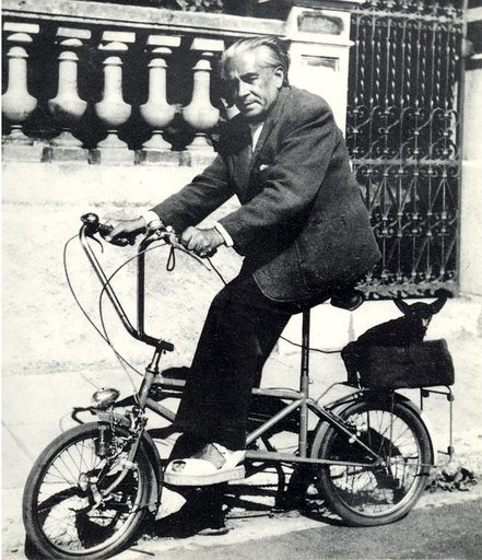 Picabia, Francis (1879-1953) on his bicycle with his dog Ninie in September 1940 during a petrol shortage, photographed by his wife Olga.