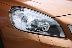 wheel(0.0), automobile(1.0), automotive exterior(1.0), vehicle(1.0), automotive lighting(1.0), automotive design(1.0), light(1.0), bumper(1.0), headlamp(1.0), land vehicle(1.0), luxury vehicle(1.0),