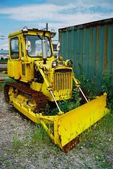 asphalt(0.0), agriculture(0.0), field(0.0), light commercial vehicle(0.0), harvester(0.0), vehicle(1.0), transport(1.0), construction equipment(1.0), bulldozer(1.0), land vehicle(1.0),