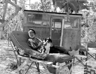 Old hermit Roy Ozmer poses with his dog on a self-made lounge chair: Gomez Point, Florida